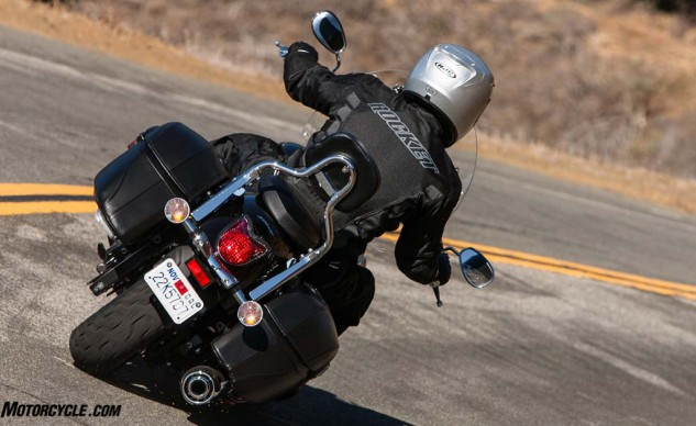 A more upright riding position, like that of a cruiser, puts the rider's helmet in a position to protect the collar opening in the event of a rain storm, thus making it much harder for water to creep in.