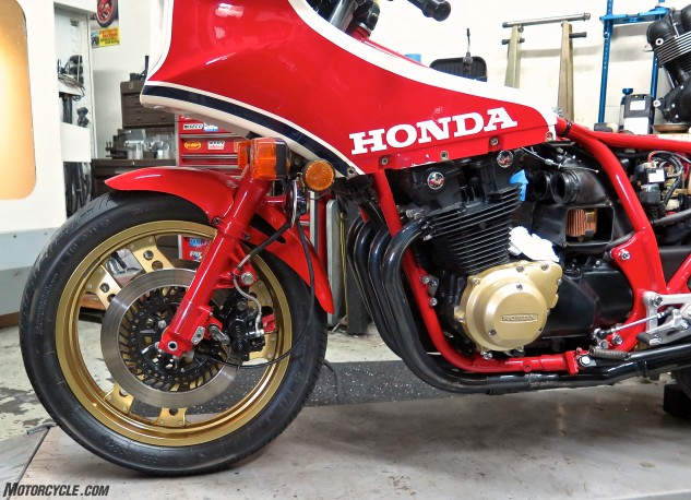 We caught the old girl with her clothes off at MotoGP Werks being serviced. Note the magnesium engine covers, mechanical anti-dive on the color-matched fork tubes. The front discs are radially vented like automobile and CBX ones, and the CB is allegedly the first Honda with two-piston calipers. When Australian race officials banned the '82 for its fairing projecting beyond the front axle, Honda changed the fairing for '83. (When they'd banned the '81 for having no passenger seat, Honda added a removable seat hump on the '82. What next, bitches?)