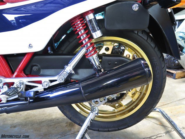 Grant says his bike's not restored, but it's harder to believe him than usual. The black chrome exhaust looks like new; so do the gold Comstar wheels, remote-res fully adjustable Showa dual shocks, alloy footpeg carriers and all the rest of it. The black box carries the toolkit.