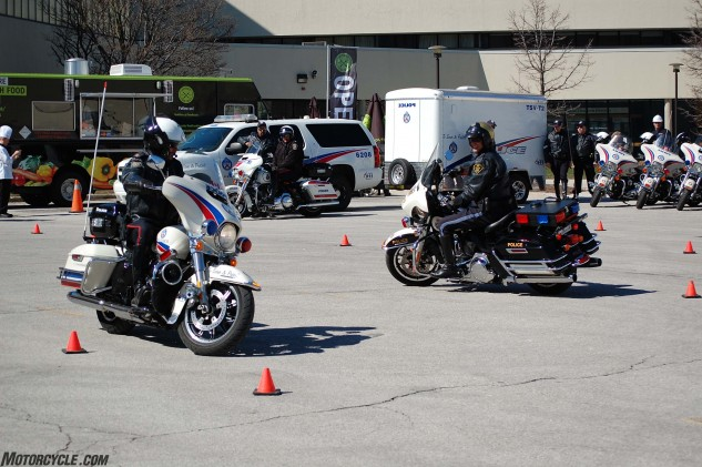 Officers demonstrated slow-speed maneuvers, riding their big, heavy police Harleys in tight circles. Not once did a boot touch the ground, though the same can't be said of an occasional exhaust pipe.