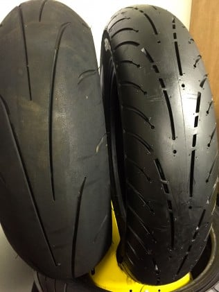 """The new Elite 4 (right) totally derives its """"cosecant"""" tread pattern from Dunlop's performance tires ala the Q3 (left). The small """"bridges"""" in the grooves eliminate cupping over the much longer projected life of the Elite. When the round holes are gone, it's time to think about new tires."""
