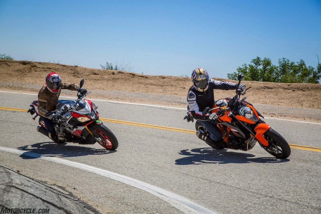 Six of one, half dozen of the other. Do you prefer a V-4 or a Twin? Steel trellis frame or aluminum twin spar? Orange and black or silver and red? These are the choices you'll be grappling with choosing between these motorcycles because both are so damn awesome there's no definitive reason why one is better than the other.