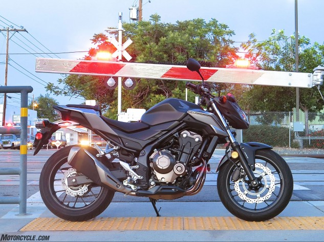 Honda says the new exhaust gives better mass centralization and a crisper exhaust note. It's still a super-quiet non-obnoxious little bike, except when you honk the horn instead of the turnsignal button because they're reversed. Why? Photo by JB.