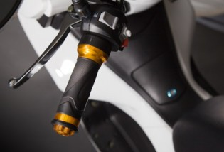 No, that's not a clutch lever. It's the rear brake lever.