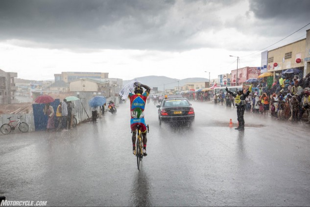 During my time in Rwanda, it rained every single day, hard – a challenge for bicycle and motorcycle riders alike. Photo by Mjrka Boensch Bees.