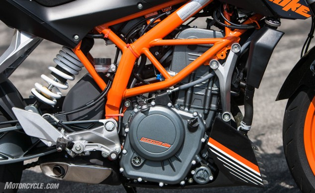 It's not put together as seamlessly as the Honda, but the KTM is littered with tasty nuggets including its trellis frame, and cast aluminum swingarm. Like the RC390, it also has not enough room between its exhaust and shock for even a heat shield.