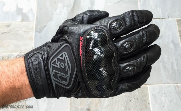 The structured composite knuckle armor will spread out the surface area of any impacts, and the thermoplastic TLD logo offers abrasion resistance.