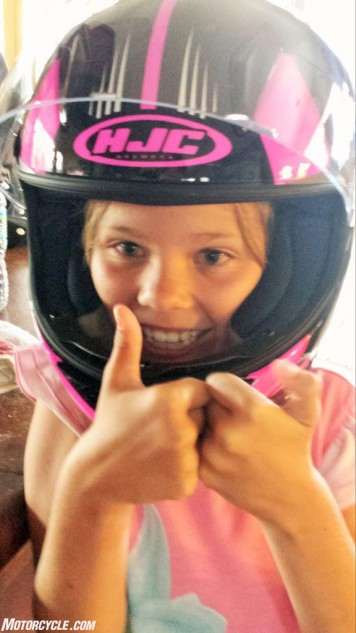 Now that she's keen on riding, it's time to properly gear her up. HJC is one of just a handful of helmet companies manufacturing youth-size helmets, and the CL-Y pictured here is notably smaller and lighter than an adult-sized HJC with a similar interior size.