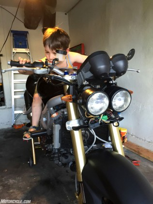 Author's son, contemplating how many Lego kits the author could have bought instead of a second SV650.