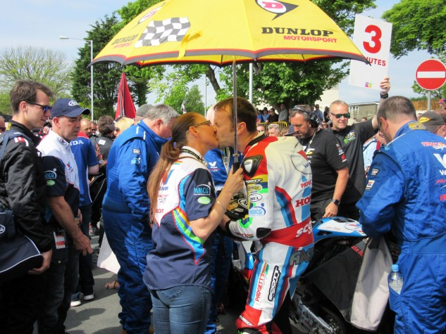 Bruce Anstey shares a moment with his partner Anny Ramsey before blasting down Bray Hill. Photo by Andrew Capone.