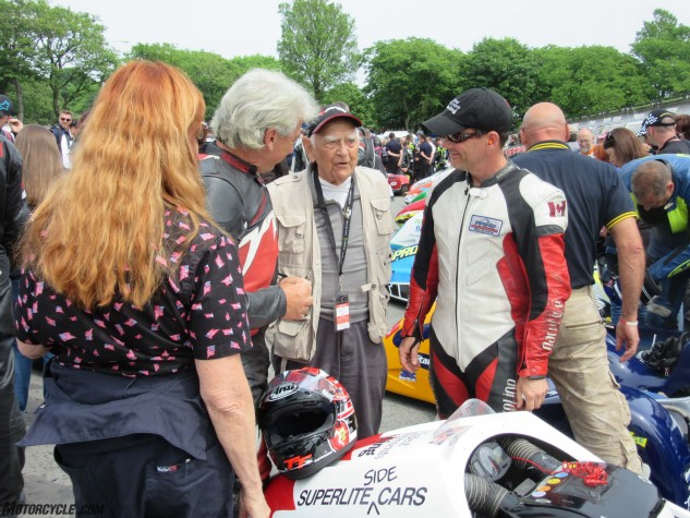 Former World Sidecar Champion Stan Dibben, now 91, at the Parc Ferme prior to the Sidecar TT Race.
