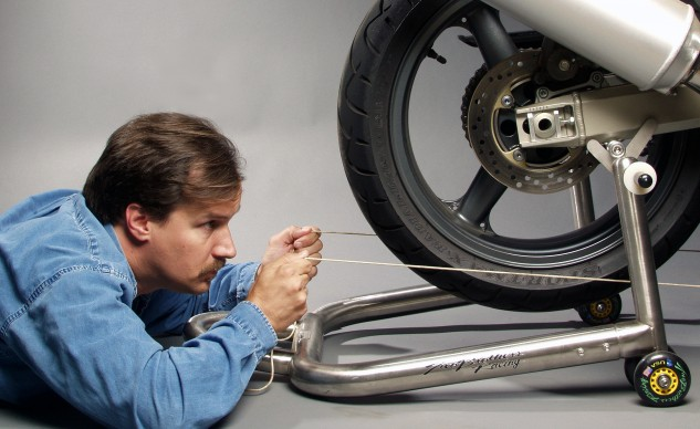 Using a string to check wheel alignment may seem like a lot of work, but a crooked rear wheel will trash an expensive chain and sprockets and could affect the bike's handling.