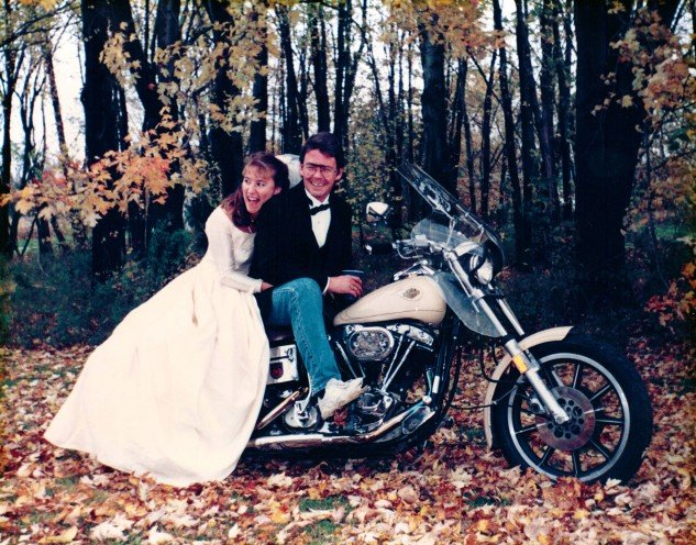 These H-Ds have been stalking us for decades; wedding day, Wife Number 2, and a neighbor-friend insists we get a photo on his bike to mark the occasion. It beats thinking about peeing in a plastic can.