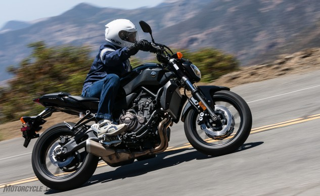 At 397 lbs soaking wet, the Yamaha FZ-07 changes direction nearly as quickly as the KTM, but its chassis loses some composure on rough roads.