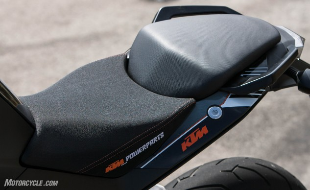 KTM's Ergo Seat uses much nicer materials (note its softer textured surface next to the plasticky pillion saddle) and is well worth its $130 price as long as your legs aren't especially short.