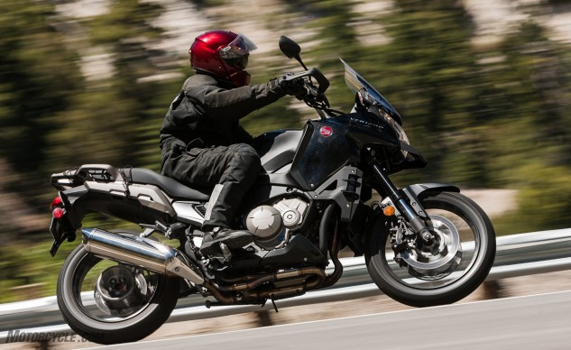 The VFR1200X is confusing. High handlebars seem clumsy, and the bike's wide tank is a lot to wrap your legs around when seated, and uncomfortable when standing. Street pegs with non-removable rubber inserts underline the VFR1200X's pseudo off-road acumen.