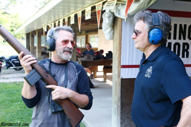 MO's beloved savant, John Burns fondles one of Springfield's walnut-stocked M1-A rifles, prior to drawing a bead on a 100-yard target. It was no problem for the eagle-eyed graybeard.