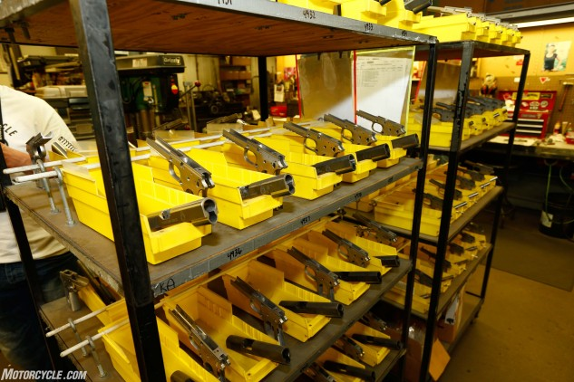 """The factory tour portion of our week began at Springfield Armory in Geneseo, Illinois. The pistol parts shown here await meticulous hand-fit construction by the expert craftsmen in the Springfield Custom shop. To make a moto analogy, these are the true """"works machines"""" of the company line."""
