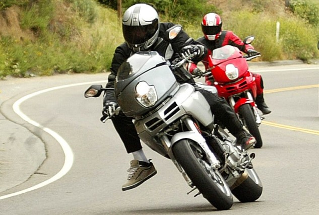 Just five months after demolishing my ankle, and still with a walking cast on my leg (necessitating the odd oversized footwear), I was riding Ortega Highway at the domestic launch of Ducati's 2003 Multistrada. I had to keep lifting my right foot off the peg so it wouldn't drag in corners.