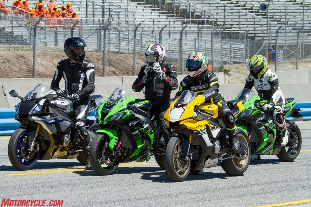 """Racing royalty: That's King Kenny Roberts Sr. on the Anniversary Edition R1 with Kenny Jr. to his right on the Kawasaki. Alpinestars owner Gabriele Mazzarolo is aboard the R1M on the left, while <i>MO</i> friend Kaming Ko is tailing behind. Junior, the world GP champion in 2000, said it was the first time he'd been on a motorcycle in 10 years! Upon leaving the pits, an unsuspecting trackday control rider asked the anonymously-outfitted rider on the yellow R1 whether he needed a tow around the track. """"Dude, I'm Kenny Roberts,"""" he said."""