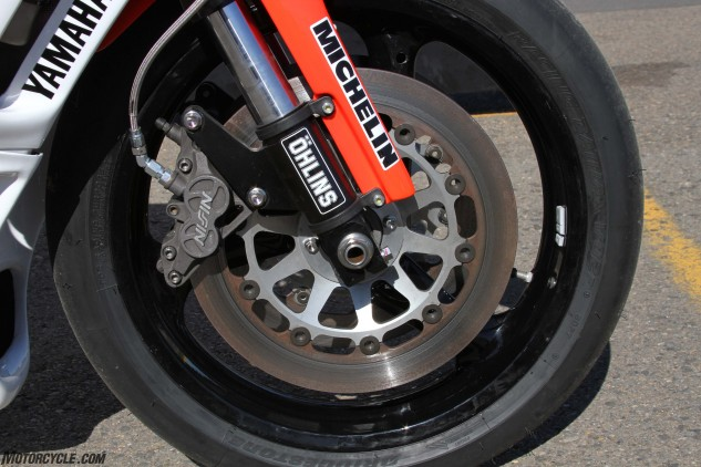 The replica uses the same front wheel, forks, rotors and calipers as the original 1990 YZR500.