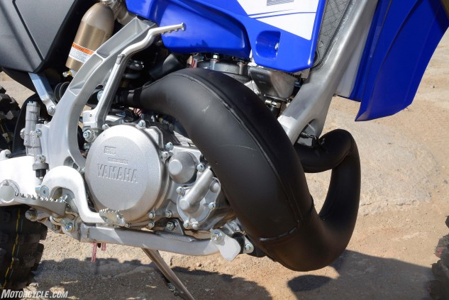 The YZ250X's 249cc two-stroke Single features the same 66.4mm × 72.0mm bore and stroke as the YZ250, but it has a slightly lower compression ratio, milder ignition timing and more off-road friendly power valve settings. The X's pipe is also redesigned to provide better ground clearance.