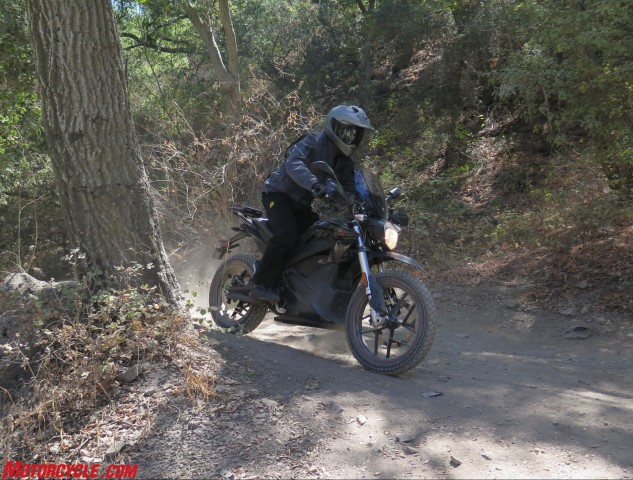 A higher handlebar wouldn't hurt, but the bike's suspension and 19/17-inch wheels make quick work of dirty backroads.