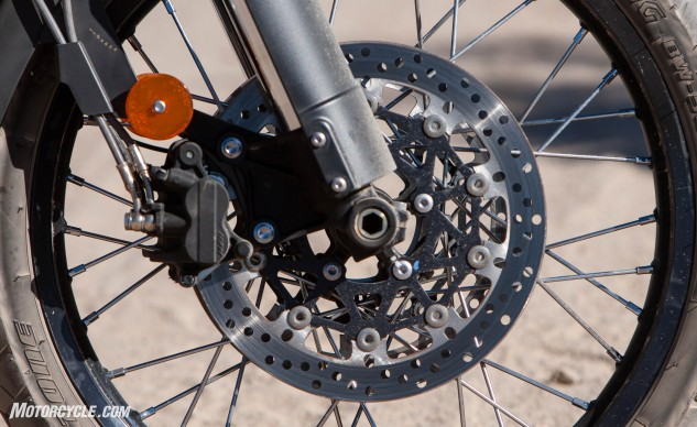 Twin front 308mm floating discs and Nissin 2-­piston calipers with switchable ABS provide ample stopping power on both paved and unpaved surfaces.