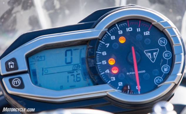"The instrument cluster will be recognizable to anyone familiar with Tigers. The ""M"" button on the left selects preset Road and Off-Road modes, as well as your customized Rider mode. Other info includes speed, fuel and temp gauges, odo and tripmeters, clock and GPI."