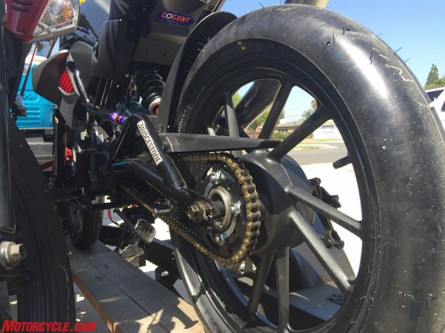 Nothing makes a racer feel warm, fuzzy, and confident quite like a pair of slicks, and one benefit of having 17-inch wheels as the Kymco does is the selection of rubber available. These Bridgestone V02 medium compound slicks were introduced in 2014, incorporating lessons learned from B-Stone's time in MotoGP. This makes them entirely too nice to put onto our K-Pipe, but we did anyway.