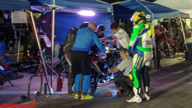 A rider change and bike check somewhere in the middle of the night.