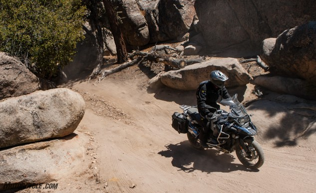 Given the same tires as the Ducati, the BMW would probably hang with the more powerful, equally heavy, but more top-heavy Ducati. Our GS included the BMW dongle that allows for Enduro Pro mode, which made all of us better riders in the dirt.