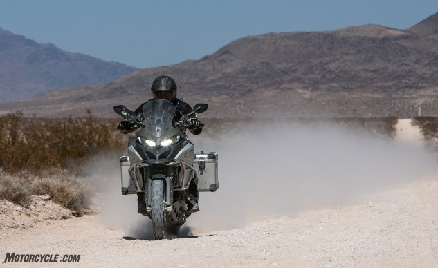 """When it came to suspension performance,"" says Rousseau, ""the Ducati was again a surprise. At one point I inadvertently ran smack dab through a few Hare & Hound-style sand whoops while moving at a decent clip during our short desert hop through Lucerne Valley. The suspension competently soaked up hits that might otherwise have resulted in the mother of all yard sales. Later, I took the time to change my shorts…"""