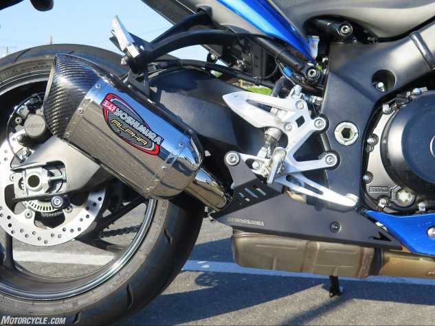 """The Yosh Alpha pipe really did """"slip on"""" perfectly, including the nice cosmetic cover that matches the Suzuki's frame."""