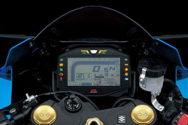 TC 5, Cap'n. Suzuki Drive Mode Selector (A,B and C) allows the rider to pick one of three engine power delivery characteristic settings. This is the GSX-R1000 panel; the GSX-R1000R gets light numerals on a black background. Both are 6-way brightness adjustable and packed with a ton of info.