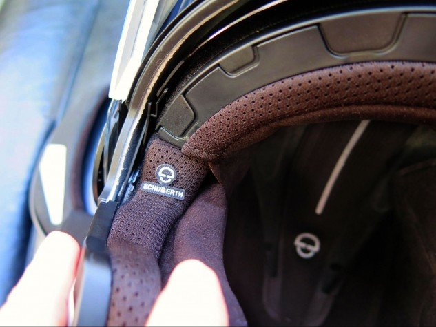 Right about where the Schuberth logo is would be a good place to leave an indent for glasses. The fully removable/washable interior is made of COOLMAX and Thermocool and other high-tech materials designed to keep your head cool and dry.
