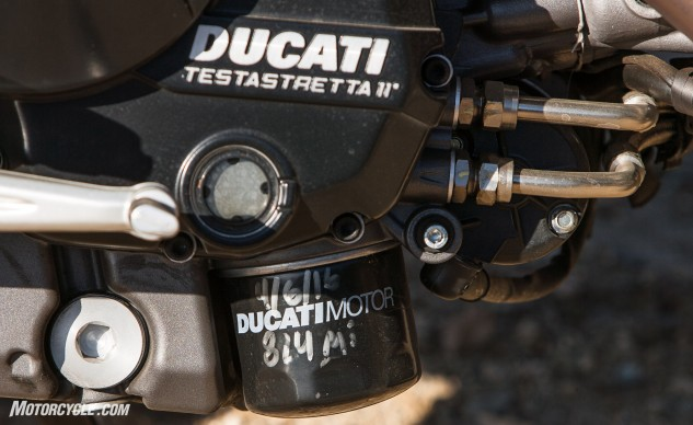 The higher-compression, larger-displacement engine in the 2016 939 Hypermotard SP offers equal performance for the non-SP model. Valve adjustments come once every 18,000 miles, changing the oil filter is something you can do at home.