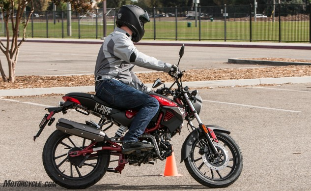Compared to the other three bikes, the Kymco is the least cramped for adult-size riders. The seat offers plenty of space to move about, while bars and pegs are placed in a neutral position.