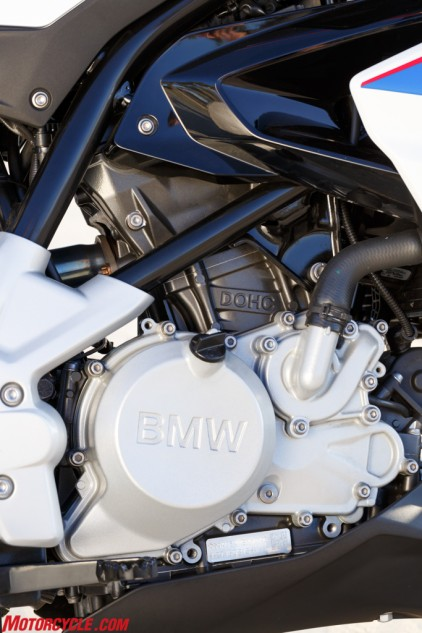 BMW's 313cc Single powering the G310R breaks from tradition and has its cylinder head spun 180º compared to traditional single-cylinders. It's also small, compact, and wedged as far forward as possible for better weight distribution.