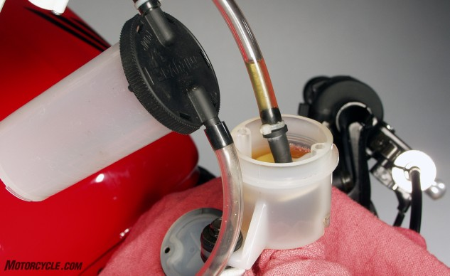 If you're using a vacuum tool, the bleeding process can be sped up by sucking the old fluid out of the reservoir.