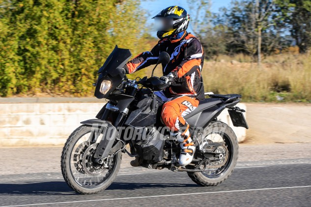 KTM is clearly trying to hide something, as evidenced by the engine component heavily wrapped in tape.