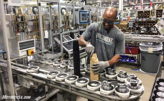 Preparing pistons for one of the automated processes.