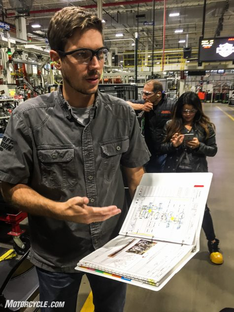 Manager of Engineering, Manufacturing Jared Olsen explains the importance of the Job Instruction Manual. This book contains the annotated assembly instructions jointly developed during the Milwaukee-Eight's design by the engineers and the assembly line employees.