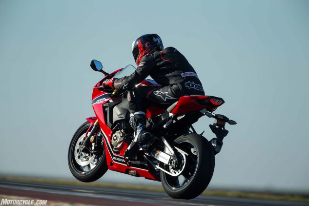 The Portimão track is a wheelie-lover's dream, as its extreme undulations are perfect for hoisting the front in the air. That is, unless you've got the Honda's wheelie control. Sometimes the front will crawl upwards controllably, other times it would shoot up faster than you'd expect before abruptly cutting power. Other times it won't come up at all.
