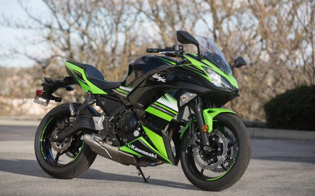 The restyled Ninja 650 is fairly aggressive for 2017, more closely resembling its supersport/superbike stablemates. The new 5-spoke wheels are lighter, and the shorter under-engine exhaust helps centralize mass. That's possibly the best looking pressed-steel swingarm we've ever seen.