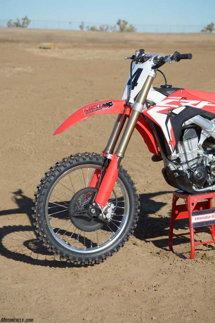 Honda has replaced the CRF450R's 48mm KYB PSF air fork with an all-new 49mm Showa coil-spring unit with internals from the company's Race Kit suspension. The Showa outperforms the air fork by being more sensitive over smaller bumps while retaining excellent big-hit capability.