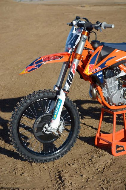 The 48mm WP AER fork on the KTM 450 SX-F Factory Edition is the same as the unit found on the Husqvarna FC 450. The fork's spring rate is easily adjustable via a single air valve on top of the left fork leg.