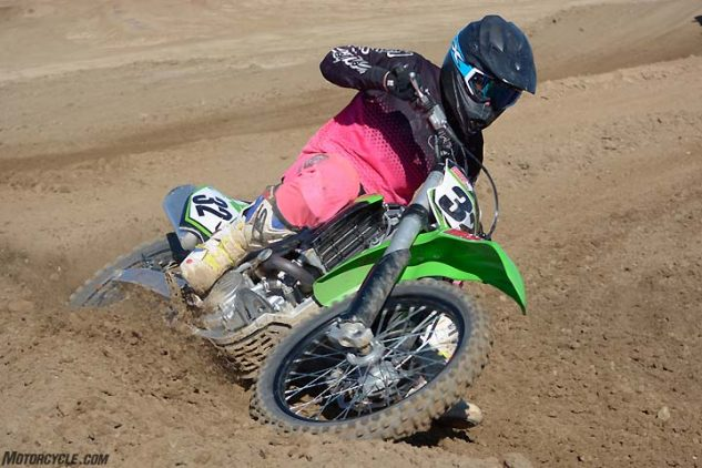 """While it is one of the best-handling Kawasaki KX450Fs in recent memory, the Kawasaki's steering isn't the most responsive in the group, trading excellent straight-line stability for a """"steer with the rear"""" attitude when cornering."""