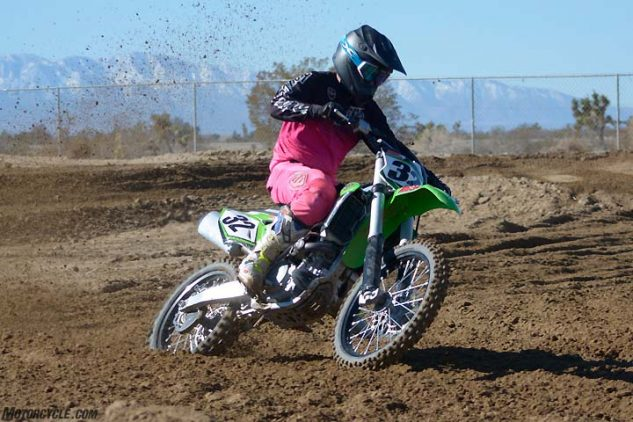 """The Kawasaki barks cleanly out of corners, but our test crew was expecting more of a hit and a stronger pull at higher rpm. Throttle response is best when Kawasaki's """"lean"""" DFI power coupler is plugged into the KX's ECU."""
