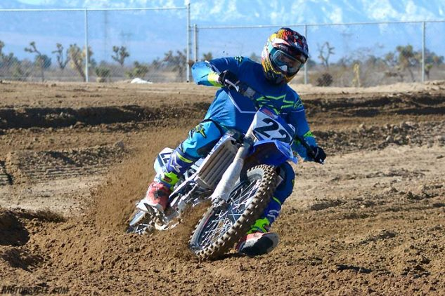 The YZ450F has a decidedly big and wide feel, and it tends to push wide off of corners, forcing the rider to make sure to get forward before initiating a turn. Its straight-line stability is excellent.